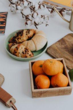 kaboompics_Orange - croissant - cutting board ona table.jpg